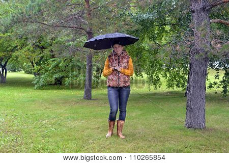 The Woman With An Umbrella And In Gumboots Costs In Autumn Park