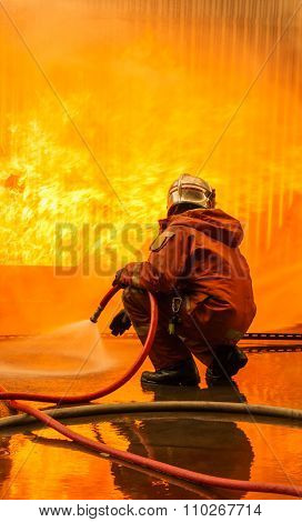 Fireman Fighting A Burning Flames