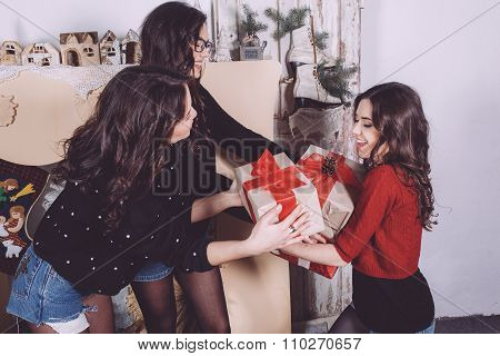 Beautiful girl exchange gifts for the new year