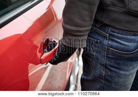Car Thief Trting Door Handle To See If Vehicle Is Unlocked