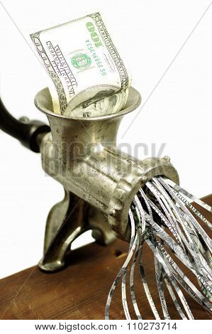 100 dollar bill in a meat grinder
