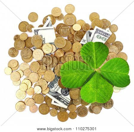 Clover leaf, golden coins and dollars on white surface