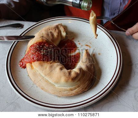 Panzerotti, closed pizza tasting with olive spicy oil in Italy