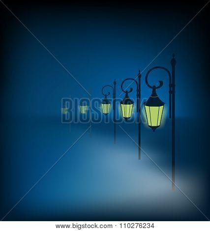 Lanterns stand in fog on dark blue