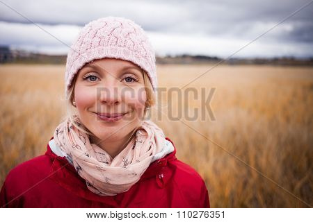 Happy Woman On A Cold Autumn Day