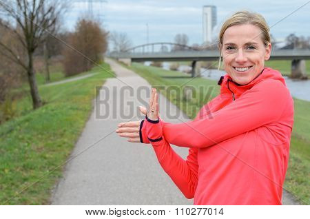 Athletic Adult Woman Stretching Her Arm