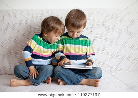 Two Boys, Playing On Tablet