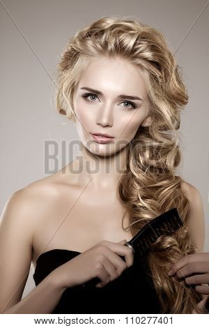 Model with long braided hair. Waves Curls Braid Hairstyle. Hair Salon. Updo. Fashion shiny hair. Woman with healthy hair, girl with luxurious haircut. Hair loss, braiding hair volume.