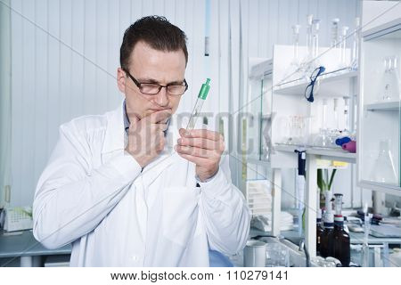 Scientist observing test tube at the laboratory