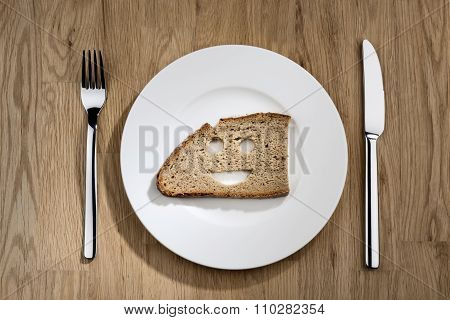 Bread With Smiling Face On A White Plate
