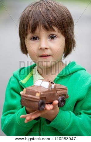 Funny Little Boy Playing With Car Of Chocolate, Outdoor