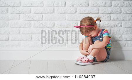 Little Child Girl Crying And Sad About Brick Wall