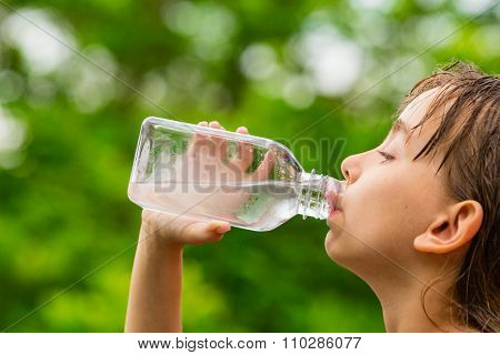 Girl Drinking Clean Tap Water From Transparent Plastic Bottle
