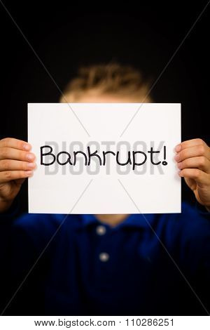 Child Holding Bankrupt Sign