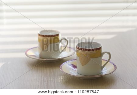 Two Little Coffee Cups.