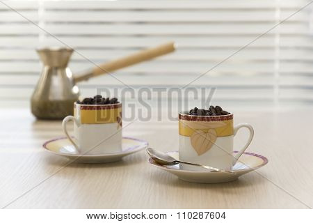 Two Cups With Coffee Grains.