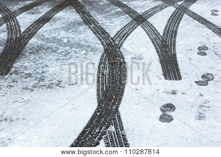 Car trace. Winter road.
