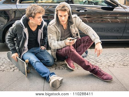 Young Hipster Fashion Brothers Having Fun With Smartphone - Best Friends With Smartphone