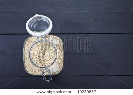 Oatmeal On Dark Wooden Background