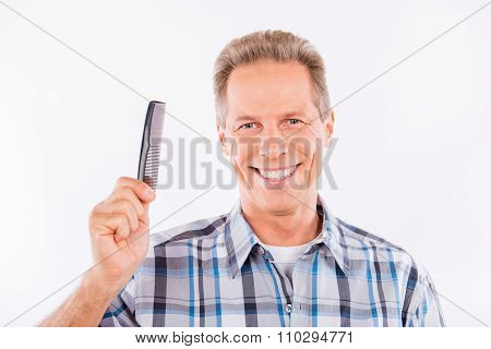 Confident Aged Man Holding A Comb