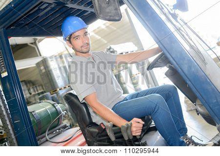 Man driving fork lift