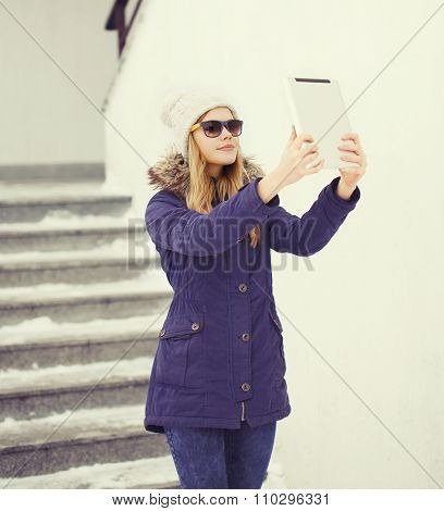 Pretty Young Girl Makes Self Portrait On Tablet Pc Outdoors In City