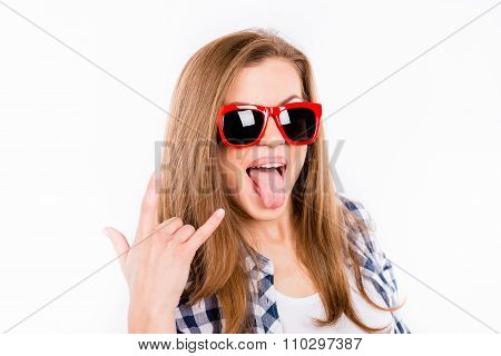Funny Girl In Glasses With A Red Rim Showing Thumbs Up Gesture Rock End Roll