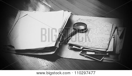 Vintage Documents With Magnifying Glass