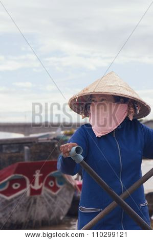 Woman at floating market, Vietnam
