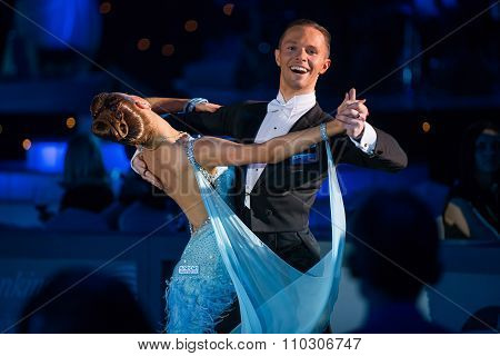 Dance couple performs at the ballroom dance event