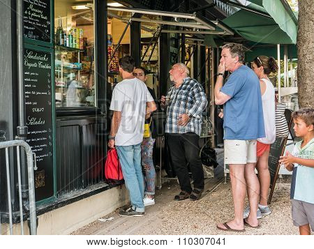 Visitors Choose Snacks At Cafe Take-away Window In Jardin De Luxembourg, Paris