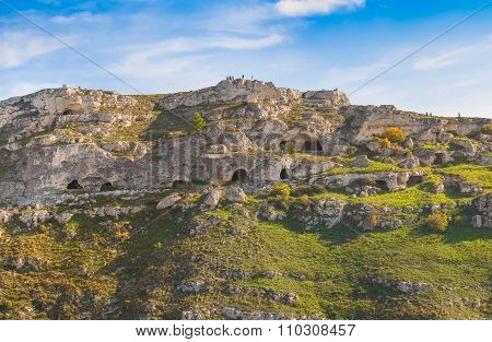 Rupestrian House And Church, Historic Building. Sassi Of Matera. Basilicata Under Blue Sky