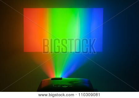 projector in action with illuminated rgb screen