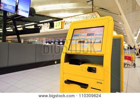 AMSTERDAM, NETHERLANDS - NOVEMBER 17, 2015: self check-in kiosk in Amsterdam Airport Schiphol. Amsterdam Airport Schiphol is the main international airport of the Netherlands.