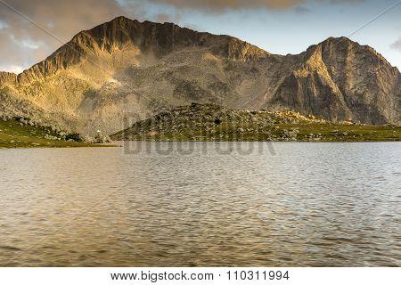 Yellow Sunset over Tevno Lake and Kamenitsa peak