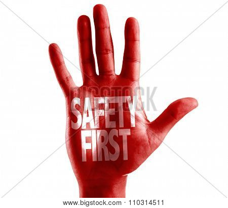 Safety First written on hand isolated on white background