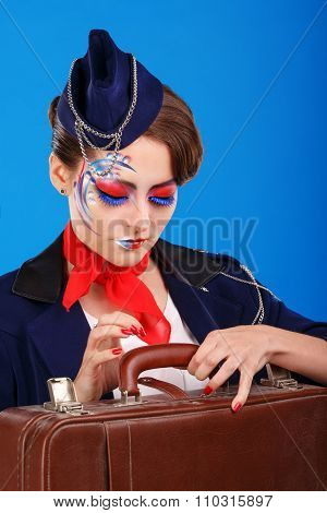 Stewardess With Face Art Baggage Checks.