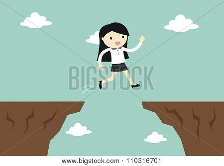 Business concept, business woman jump through the gap to another cliff.