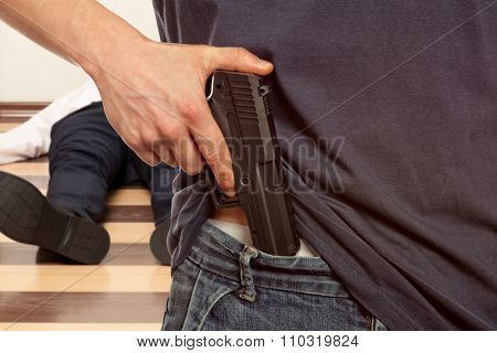 Man holding gun against a corpse background