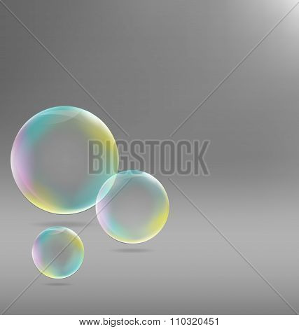 Three transparent soap bubbles with shadows on grayscale