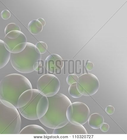 Transparent green soap bubbles on grayscale