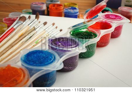 Paint brushes with opened paint bucket