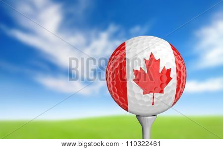 Golf ball with Canada flag colors sitting on a tee