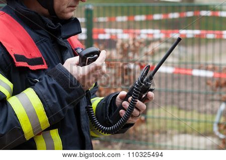 German fireman calls with a walkie talkie