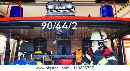 A fireman phone in the fire truck