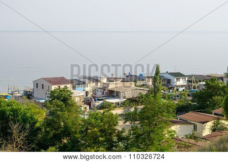 City On Seafront With Tree And Mountains