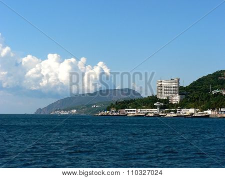 City On Seafront With Big Mountain