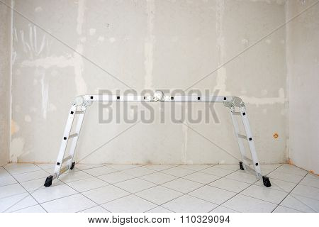 Metal ladder standing in the room