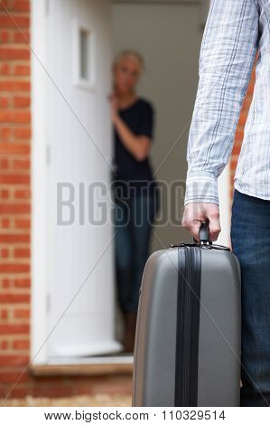 Man With Packed Suitcase Leaving Wife