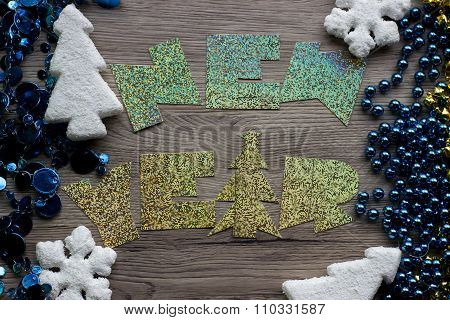 Holiday decorations closeup on wooden background with holographic inscription